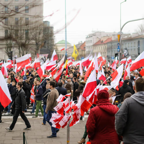a crowd of people that carry poland flags