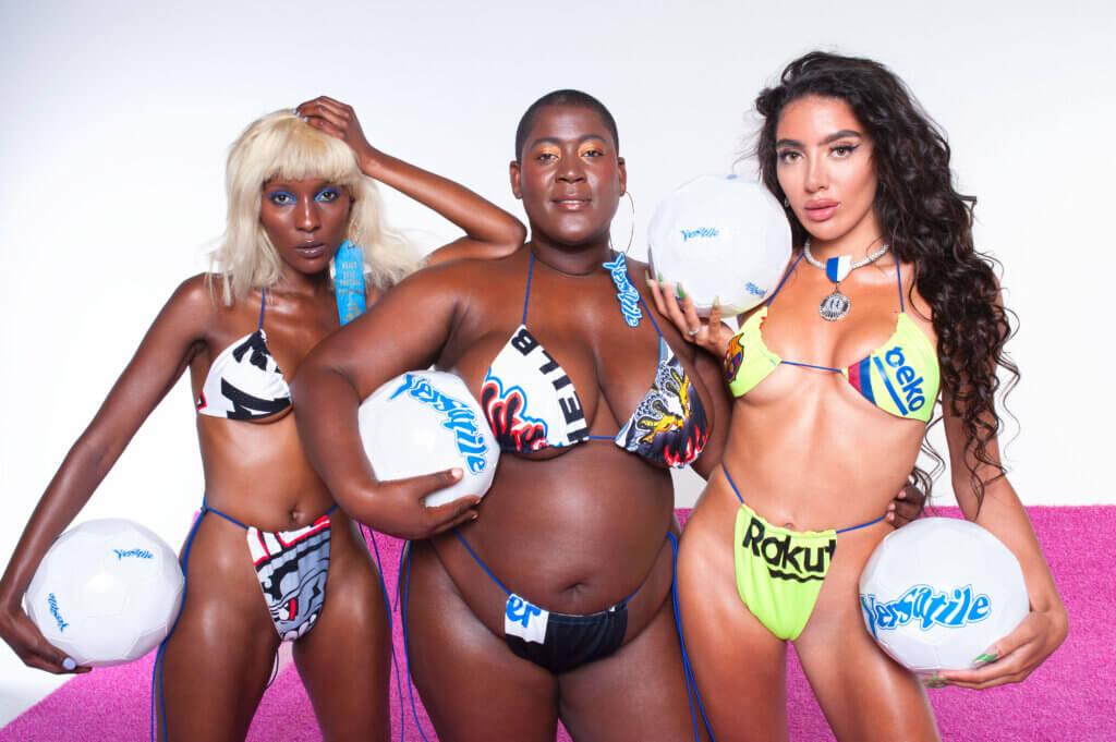 three women in bikins from Versatile Forever, holding water balls